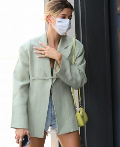Hailey Bieber seen in leggy outfit into a meeting.