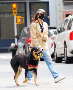 EXCLUSIVE: Emily Ratajkowski turns heads when walking her dog Colombo a few days after publishing her article on reclaiming her own image and accusing photographer Jonathan Leder of sexual assault
