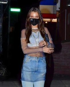 Brooklyn, NY  - Bella Hadid beams with beauty as she shows off her new hairstyle while heading to her pre-birthday dinner party with friends in Brooklyn. The model turns 24 on October 9th.